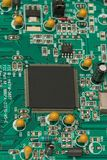 PCB. Printed circuit board with square microprocessor and other components royalty free stock photos