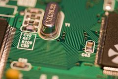 PCB board with ICs. PCB board with small electronic devices - small DOF Stock Photography