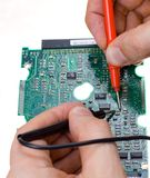 PCB diagnostics. And measurement by means of a multimeter royalty free stock images