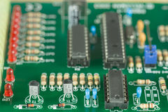 A pcb with electronic components. A green printed circuit board with electronic components Royalty Free Stock Photos