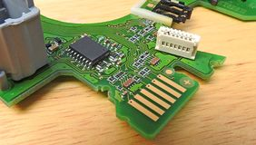 Pcb printed circuit board comms unit control panel switches points microchip electronic. Photo of a printed circuit board comms electronic unit showing switches royalty free stock image