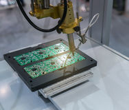 PCB Processing on CNC machine working. In factory stock images