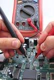 PCB testing. Hands with measurement device, voltometer. PCB testing Stock Photography
