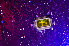 PCB witn CPU core. Color lighting. Royalty Free Stock Photos