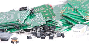 PCBs with different electronic parts Stock Photos