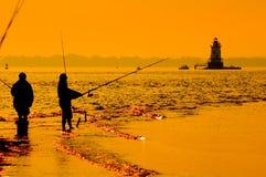 Pêche dans la vague déferlante 4 Photos libres de droits