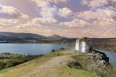 Pchelina lake in Bulgaria and the old chapel St.John Royalty Free Stock Photo