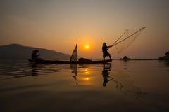 Pêcheur de coucher du soleil Photos stock