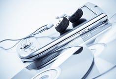 PDA, auriculares y Cdes Fotografía de archivo libre de regalías