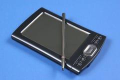 PDA on Blue Background Stock Photo