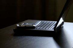 PDA in cima al computer portatile Immagine Stock