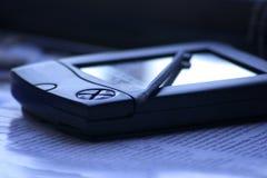 PDA con la aguja fotografía de archivo libre de regalías