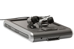 PDA con los auriculares se cierran para arriba Fotografía de archivo libre de regalías