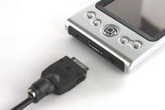 PDA e cabo da sincronização Foto de Stock Royalty Free