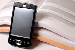 PDA e livros Imagens de Stock