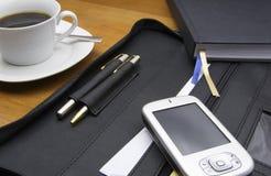 PDA en la oficina   imagen de archivo libre de regalías