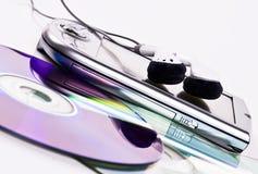 PDA,  headphones and CDs Stock Photos