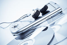 PDA,  headphones and CDs Royalty Free Stock Photography
