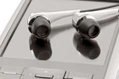 PDA with headphones close up Stock Photo