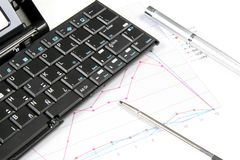 PDA and Keyboard with Chart stock photography