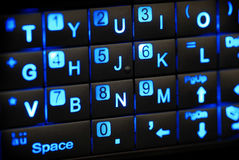 PDA Keypad. A mobile PDA glowing keys on the slide out keypad Stock Photography