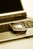 PDA on laptop sepia Royalty Free Stock Photos