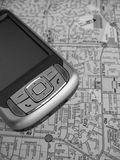 PDA Map. A Smartphone PDA with GPS capability. The background is a street map. This is a black and white image Royalty Free Stock Photo