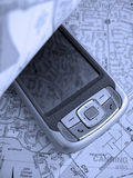 PDA Map. Turning over the page of a street map reveals a Smartphone PDA with GPS capability. The image is in a blue tone
