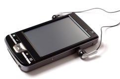 PDA met hoofdtelefoons Royalty-vrije Stock Afbeeldingen