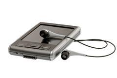 PDA met hoofdtelefoons sluit omhoog stock afbeelding