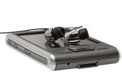 PDA met hoofdtelefoons sluit omhoog royalty-vrije stock fotografie