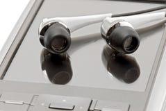 PDA met hoofdtelefoons sluit omhoog stock foto