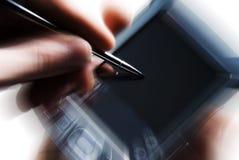 PDA met motieonduidelijk beeld Stock Foto