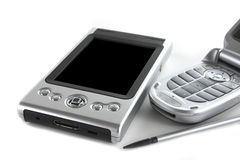 PDA and mobile Phone. Pocket PC and mobile phone isolated over white background Royalty Free Stock Photo