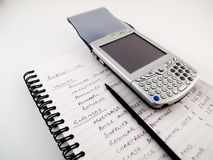 PDA Modern Mobile Cellphone on Handwritten Budget Stock Photo