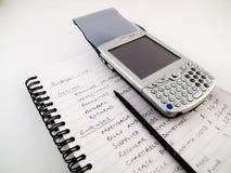 PDA Moderne Mobiele Cellphone op Met de hand geschreven Begroting Stock Foto
