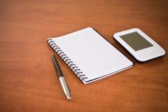 Pda, notebook and pen Royalty Free Stock Photos