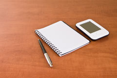 Pda, notebook and pen Stock Images