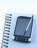 Pda on notepad Royalty Free Stock Photo