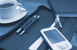 PDA in the office. Office scenario displaying a PDA pocket-PC, a file, some pens, a diary and some black coffee in a white cup royalty free stock photography