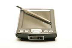 PDA & Pen. Personal digital assistant with stylus laid on the screen Stock Photography