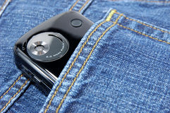 Pda phone in blue jeans pocket Royalty Free Stock Photo