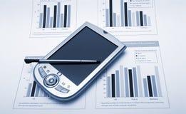 PDA sobre informes de los finaces Imágenes de archivo libres de regalías