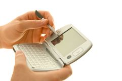 PDA and stylus in hand. Isolated over white background Royalty Free Stock Photo