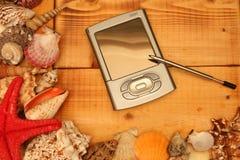 PDA su legno Fotografia Stock