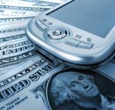 Pda y dinero Imagenes de archivo