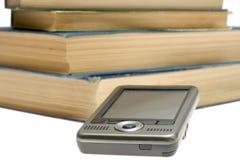 PDA y libros Fotografía de archivo libre de regalías