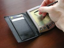 PDA y mano Imagen de archivo libre de regalías