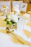 Peça central e menu do casamento Fotografia de Stock