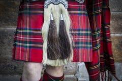 A peça da bolsa de couro e do kilt de montanhas tradicionais veste-se Imagens de Stock Royalty Free